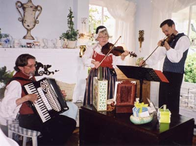 Musicians perform Swedish songs during the Midsummer Celebration at Klaradal.